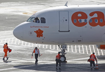 "The new logo reading ""France in the Heart"" is seen on an Easyjet airliner landing for the opening of a new base of the low cost airline at Nice International airport"