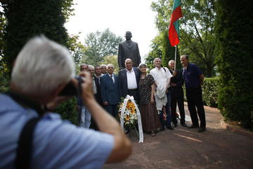 People pose for a picture in front of the monument of Bulgaria's late communist dictator Todor Zhivkov in Pravets