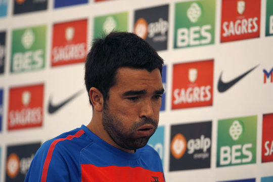 Portugal's national soccer team player Deco leaves a news conference room after it ended in Covilha