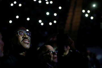 Honorary degree recipient and musician Lionel Richie listens from the audience while graduating students perform one of his songs at the Berklee College of Music Commencement Concert in Boston