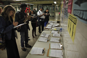 Commuters register their information to vote at elections at a subway station in New York