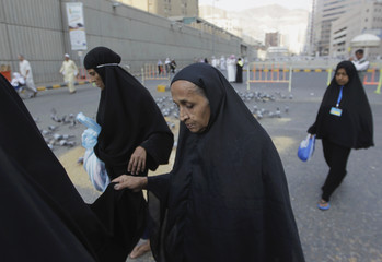Muslim women pilgrims walk to perform prayers at the Grand Mosque upon arrival in Mecca, during the annual haj pilgrimage in Mecca