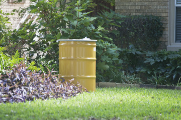 A metal barrel containing contaminated belongings of a health worker at the Texas Health Presbyterian Hospital who has contracted Ebola is in front of the health worker's residence in Dallas