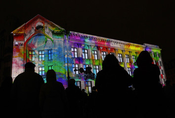"""People watch the """"Journey into a world of colourful  fairytales"""" during the """"Staro Riga"""" festival of lights in Riga"""