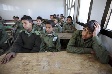 Yemeni students attend a class in Al-Kebsi school in Sanaa