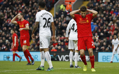 Liverpool's Adam Lallana looks dejected after a missed chance