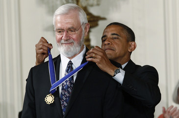U.S. President Obama awards a 2012 Presidential Medal of Freedom to physician and epidemiologist Foege during ceremony in the East Room of the White House in Washington