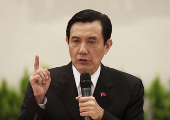 Taiwan President Ma Ying-jeou gestures while giving a speech during a news conference after his inauguration ceremony at the Presidential Office in Taipei