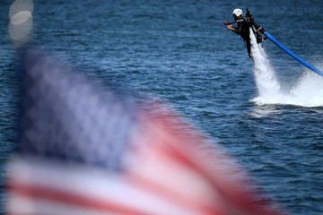 U.S. military veteran Damien Burch shoots out of the ocean on a water jetpack as part of an event by Warrior Passion and Jetpack America in San Diego