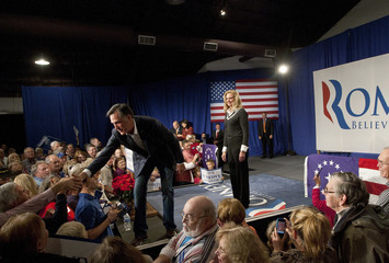 U.S. Republican presidential candidate and former Massachusetts Governor Mitt Romney shakes hands with supporters during a rally in Greenville