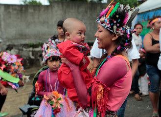 A woman and her son take part in the festivities honouring the capital's patron Santo Domingo de Guzman in Managua