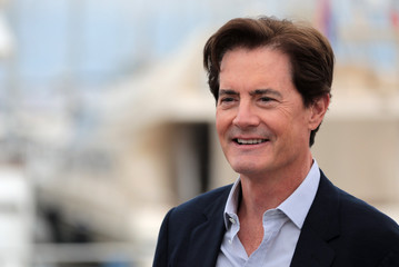 "Actor Kyle MacLachlan poses during a photocall for the television series ""Twin Peaks"" during the annual MIPCOM television programme market in Cannes"