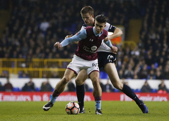 Aston Villa's Jack Grealish in action with Tottenham's Eric Dier