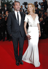 French actor Dujardin and his wife Lamy arrive on the red carpet for the awards ceremony of the 65th Cannes Film Festival