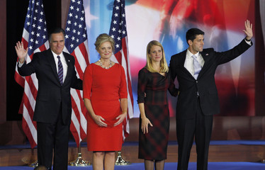 U.S. Republican presidential nominee Mitt Romney and his wife Ann with Republican vice presidential nominee Paul Ryan and his wife Janna acknowledge the audience after Romney delivered his concession speech