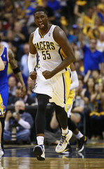 Indiana Pacers center Hibbert reacts while running down the court after he had scored on the New York Knicks during the second half of an NBA Eastern Conference second round playoff basketball game in Indianapolis