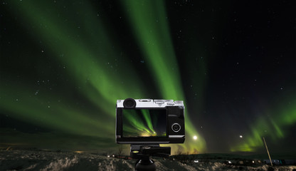 Taking photo landscape of amazing beautiful  natural phenomenon Aurora Borealis, in Iceland
