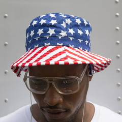 Man wears a hat with the design of the U.S. flag in Manhattan, New York