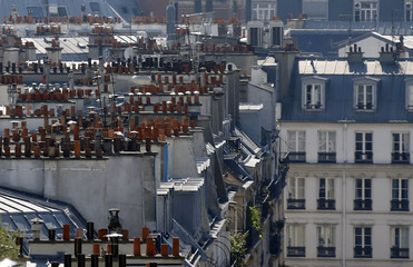 A general view shows rooftops with chimney stacks on the rooftops of residential apartment buildings in Paris