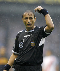 Referee Baldassi gives the kick off signal for the soccer match between Boca Juniors and River Plate in the Argentine First Division league in Buenos Aires