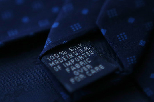 """A """"Made in USA"""" label is pictured on the back of a tie Medford"""