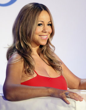 Mariah Carey smiles during a press conference announcing that she will be the new brand ambassador for the weight-loss program Jenny in New York