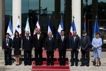 Politicians pose for a group picture during the Presidential Summit of the Central American Integration Sistem SICA in San Salvador
