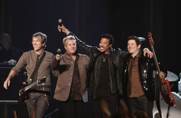 "Lionel Richie performs ""Dancing on the Ceiling"" with Rascal Flatts at the 45th Country Music Association Awards in Nashville"