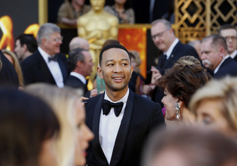 Presenter and singer John Legend arrives at the 88th Academy Awards in Hollywood, California