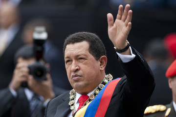 Venezuela's President Hugo Chavez waves during a ceremony in Caracas
