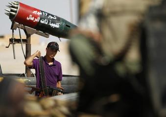 Rebel fighter patrols at town of Abu Grein