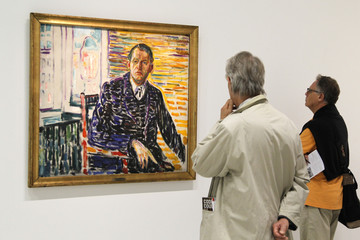 """Guests look at the painting """"Self portrait in Copenhagen"""" by Norwegian artist Edvard Munch at the Centre Pompidou modern art museum in Paris"""