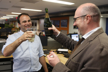 Reuters journalist Szep celebrates with colleague Bell in the Reuters Washington bureau after it was announced Szep is one of the winners of the Pulitzer prize for international reporting