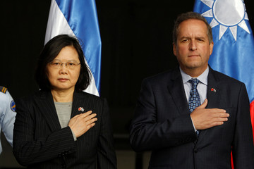 Taiwan's President Tsai Ing-wen sings the national anthem next Honduras' Vice President Ricardo Alvarez after her arrival at Palmerola military air base in Comayagua