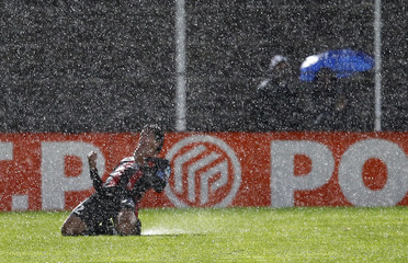 OGC Nice's Renato Civelli celebrates, under heavy rain, the third goal of his team during the French Ligue cup soccer match in Nice