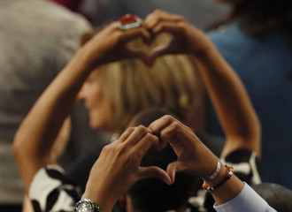 Delegates make heart symbols as the survivors and family members of gun victims speak on the third day of the Democratic National Convention in Philadelphia