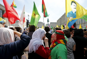Women take part in a demonstration against the Turkish army operations on Kurdish militants, in central Brussels