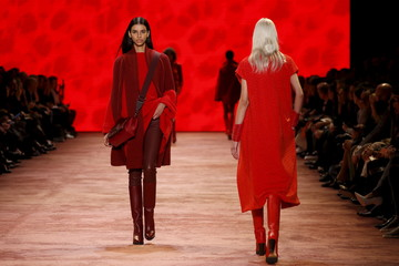 Models present creations by Swiss designer Albert Kriemler as part of his Fall/Winter 2016/2017 women's ready-to-wear collection show for Akris in Paris