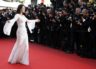 "Actress Gong Li poses on the red carpet as she arrives for the opening ceremony and the screening of the film ""Cafe Society"" out of competition during the 69th Cannes Film Festival in Cannes"