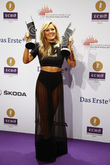 German singer Fischer poses with her Echo awards for Best German language Schlager music  and Album of The Year during the 2014 Echo Music Awards in Berlin