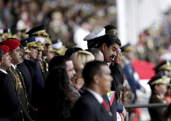 Venezuela's President Nicolas Maduro wipes the sweat from his forehead after arriving at a military parade to celebrate the anniversary of Venezuela's independence in Caracas