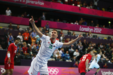 Hungary's Mate Lekai celebrates a goal against South Korea in their men's handball Preliminaries Group B match at the Copper Box venue during the London 2012 Olympic Games