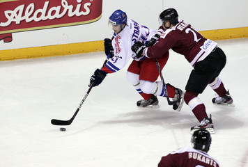 Strapac of Czech Republic fights with Berzins of Latvia during their men's Euro Ice Hockey Challenge tournament in Riga