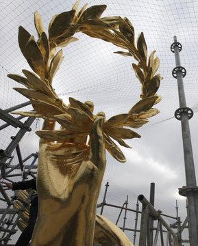 Freshly gilded laurel wreath of Golden Victoria monument is seen atop Siegessaeule victory column in Berlin