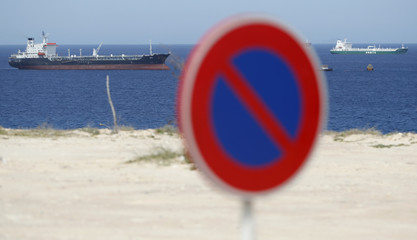 Tankers lie at anchor off the Azzawiya oil refinery in Zawiyah