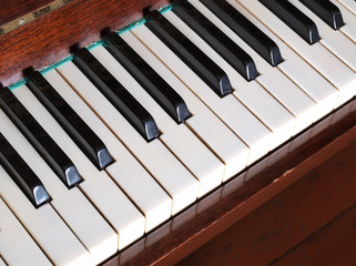 Old piano keys on a dark background