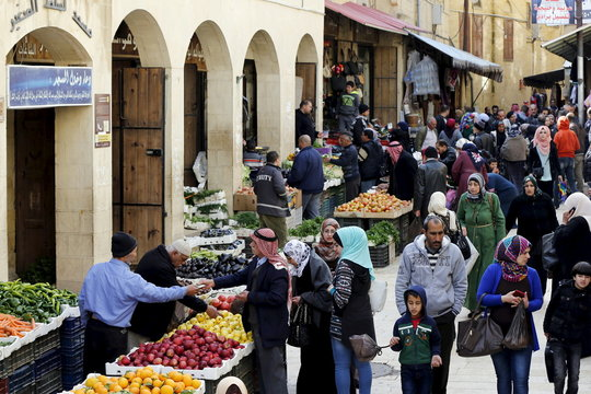People shop at the Hammam Street Market, on one of the oldest commercial streets in Salt, Jordan