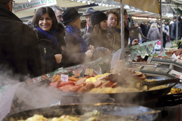 Anne Hidalgo, current Paris city deputy mayor and Socialist Party candidate in the forthcoming mayoral election, visits a market as she campaigns in Paris