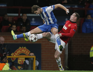 Manchester United's Rooney challenges Real Sociedad's Martinez during their Champions League soccer match at Old Trafford in Manchester