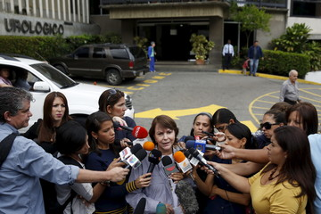 Mitzy de Ledezma, wife of arrested Caracas metropolitan mayor Antonio Ledezma, talks to the media during a news conference outside the clinic where her husband was transferred due to medical problems in Caracas